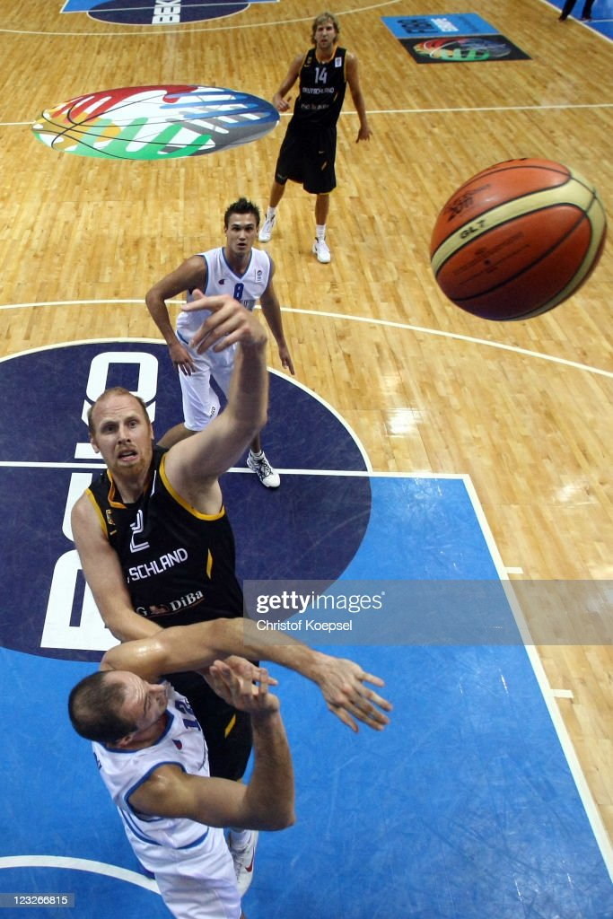 Chris Kaman (R) of Germany shoots over Marco Cusin of Italy during the EuroBasket 2011 first round group B match between Italy and Germany at Siauliai Arena on September September 1, 2011 in Siauliai, Lithuania.
