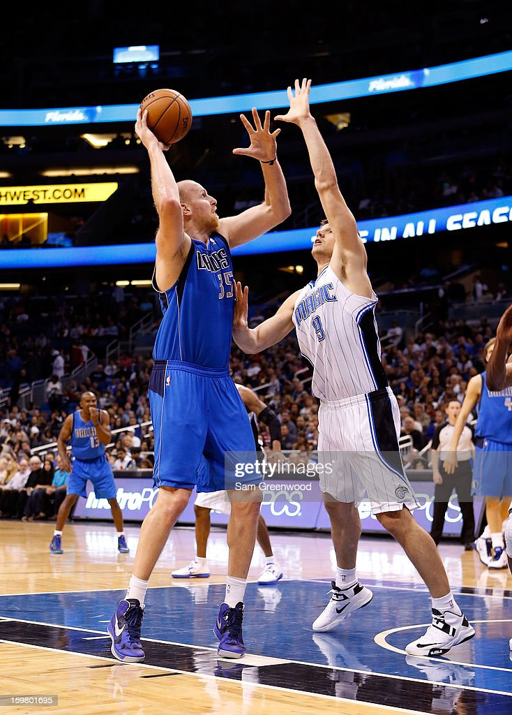 Chris Kaman #35 of the Dallas Mavericks attempts a shot over Nikola Vucevic #9 of the Orlando Magic during the game at Amway Center on January 20, 2013 in Orlando, Florida.