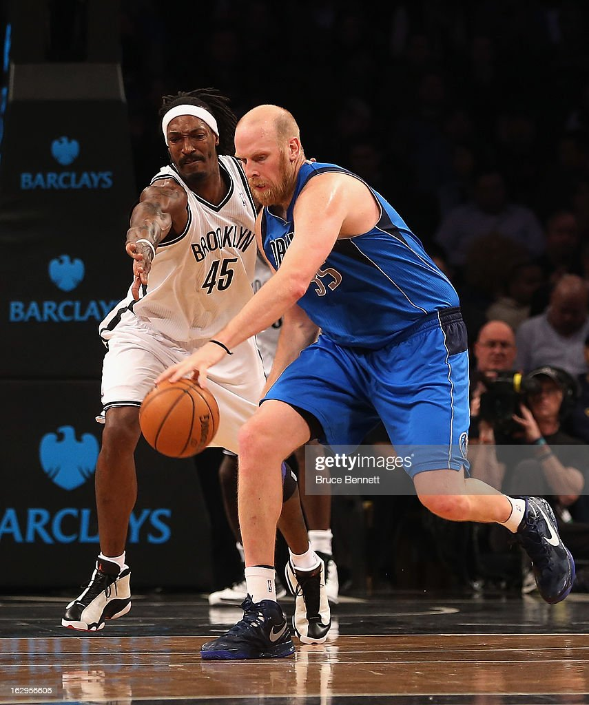 <a gi-track='captionPersonalityLinkClicked' href=/galleries/search?phrase=Chris+Kaman&family=editorial&specificpeople=201661 ng-click='$event.stopPropagation()'>Chris Kaman</a> #35 of the Dallas Mavericks dribbles the ball against the Brooklyn Nets at the Barclays Center on March 1, 2013 in New York City. The Mavericks defeated the Nets 98-90.