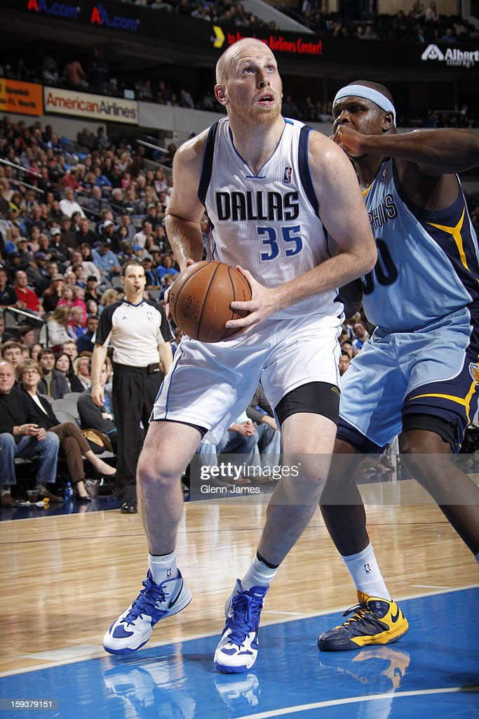 Chris Kaman #35 of the Dallas Mavericks drives against Zach Randolph #50 of the Memphis Grizzlies on January 12, 2013 at the American Airlines Center in Dallas, Texas.
