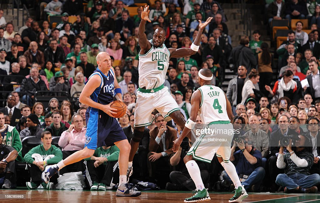Chris Kaman #35 of the Dallas Mavericks drives the ball against Kevin Garnett #5 and Jason Terry #4 of the Boston Celtics during the game between the Boston Celtics and the Dallas Mavericks on December 12, 2012 at the TD Garden in Boston, Massachusetts.