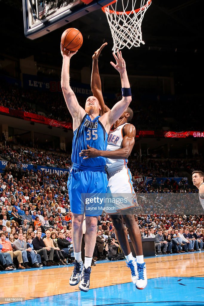 Chris Kaman #35 of the Dallas Mavericks drives to the basket against the Oklahoma City Thunder on December 27, 2012 at the Chesapeake Energy Arena in Oklahoma City, Oklahoma.