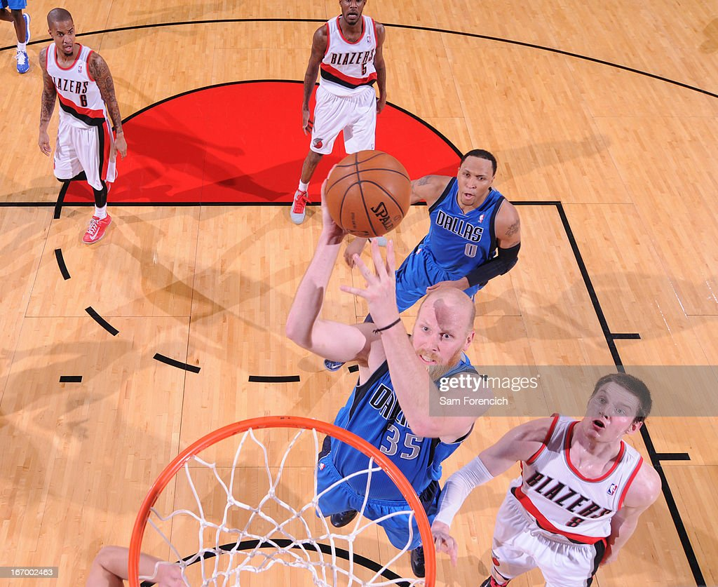 <a gi-track='captionPersonalityLinkClicked' href=/galleries/search?phrase=Chris+Kaman&family=editorial&specificpeople=201661 ng-click='$event.stopPropagation()'>Chris Kaman</a> #35 of the Dallas Mavericks drives to the basket against the Portland Trail Blazers on April 7, 2013 at the Rose Garden Arena in Portland, Oregon.
