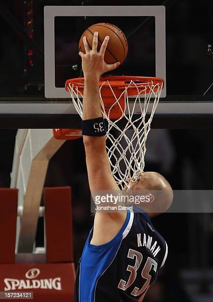 Chris Kaman of the Dallas Mavericks dunks the ball against the Chicago Bulls at the United Center on November 28 2012 in Chicago Illinois The Bulls...