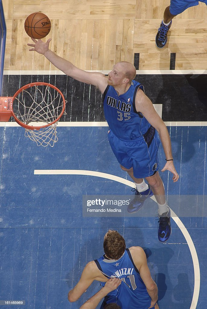 <a gi-track='captionPersonalityLinkClicked' href=/galleries/search?phrase=Chris+Kaman&family=editorial&specificpeople=201661 ng-click='$event.stopPropagation()'>Chris Kaman</a> #35 of the Dallas Mavericks goes in for the layup against the Orlando Magic during the game on January 20, 2013 at Amway Center in Orlando, Florida.