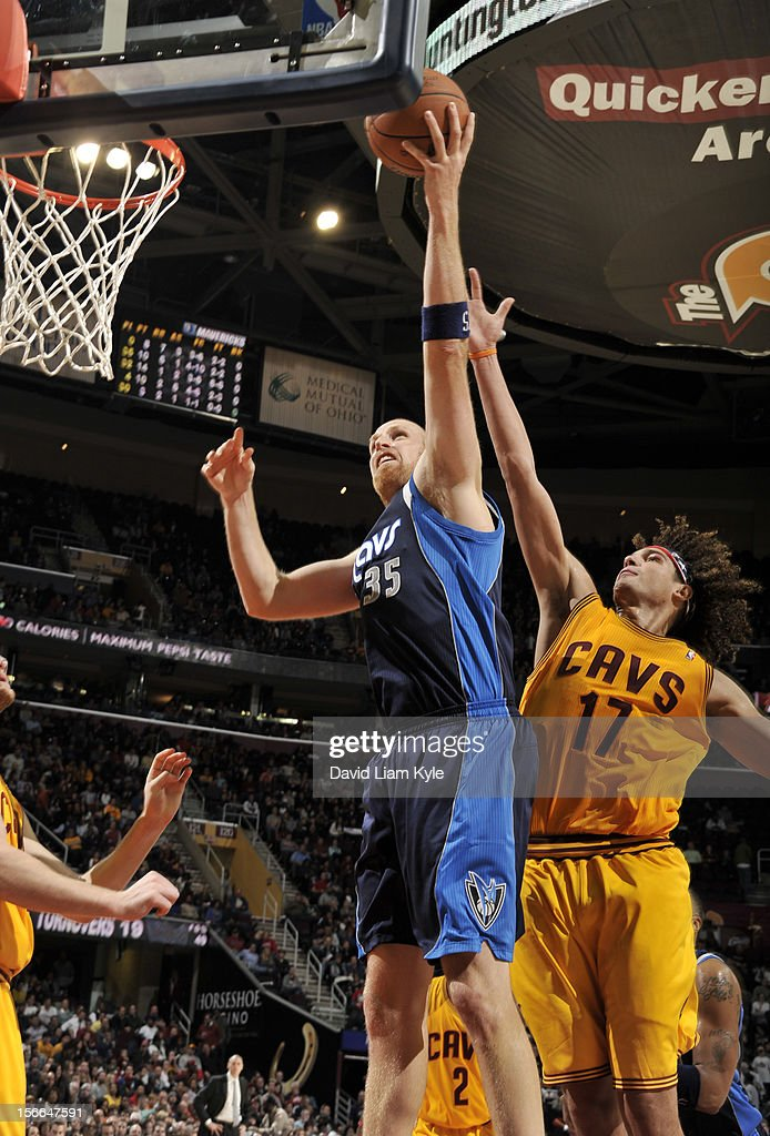 <a gi-track='captionPersonalityLinkClicked' href=/galleries/search?phrase=Chris+Kaman&family=editorial&specificpeople=201661 ng-click='$event.stopPropagation()'>Chris Kaman</a> #35 of the Dallas Mavericks goes up for the shot defended by <a gi-track='captionPersonalityLinkClicked' href=/galleries/search?phrase=Anderson+Varejao&family=editorial&specificpeople=202247 ng-click='$event.stopPropagation()'>Anderson Varejao</a> #17 of the Cleveland Cavaliers at The Quicken Loans Arena on November 17, 2012 in Cleveland, Ohio.