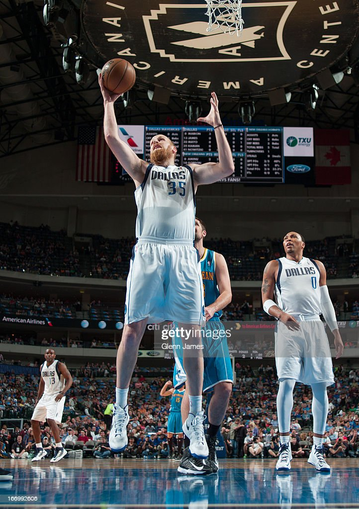 Chris Kaman #35 of the Dallas Mavericks grabs a rebound against the New Orleans Hornets on April 17, 2013 at the American Airlines Center in Dallas, Texas.