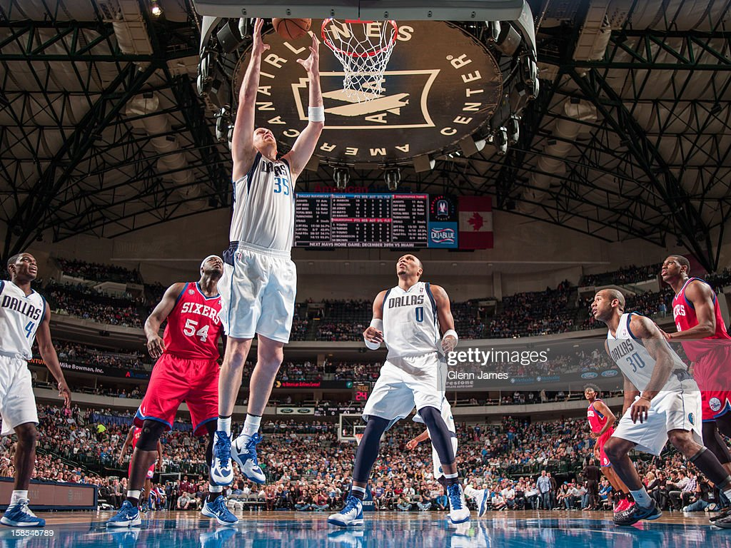 <a gi-track='captionPersonalityLinkClicked' href=/galleries/search?phrase=Chris+Kaman&family=editorial&specificpeople=201661 ng-click='$event.stopPropagation()'>Chris Kaman</a> #35 of the Dallas Mavericks grabs a rebound against the Philadelphia 76ers on December 18, 2012 at the American Airlines Center in Dallas, Texas.