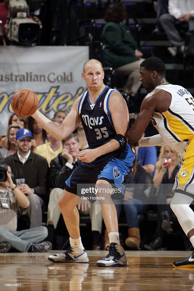 <a gi-track='captionPersonalityLinkClicked' href=/galleries/search?phrase=Chris+Kaman&family=editorial&specificpeople=201661 ng-click='$event.stopPropagation()'>Chris Kaman</a> #35 of the Dallas Mavericks makes a pass against <a gi-track='captionPersonalityLinkClicked' href=/galleries/search?phrase=Roy+Hibbert&family=editorial&specificpeople=725128 ng-click='$event.stopPropagation()'>Roy Hibbert</a> #55 of the Indiana Pacers on November 16, 2012 at Bankers Life Fieldhouse in Indianapolis, Indiana.