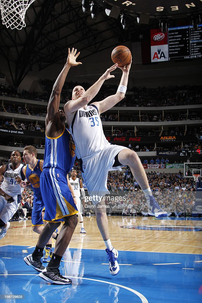 Chris Kaman #35 of the Dallas Mavericks puts up the hook shot against Festus Ezeli #31 of the Golden State Warriors on November 19, 2012 at the American Airlines Center in Dallas, Texas.