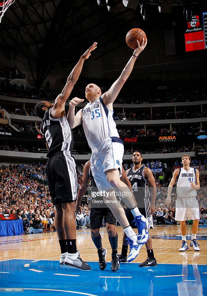Chris Kaman #35 of the Dallas Mavericks puts up the hook shot against Kawhi Leonard #2 of the San Antonio Spurs on January 25, 2013 at the American Airlines Center in Dallas, Texas.