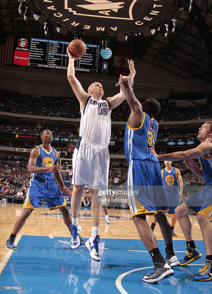 Chris Kaman #35 of the Dallas Mavericks puts up the shot against Festus Ezeli #31 of the Golden State Warriors on November 19, 2012 at the American Airlines Center in Dallas, Texas.