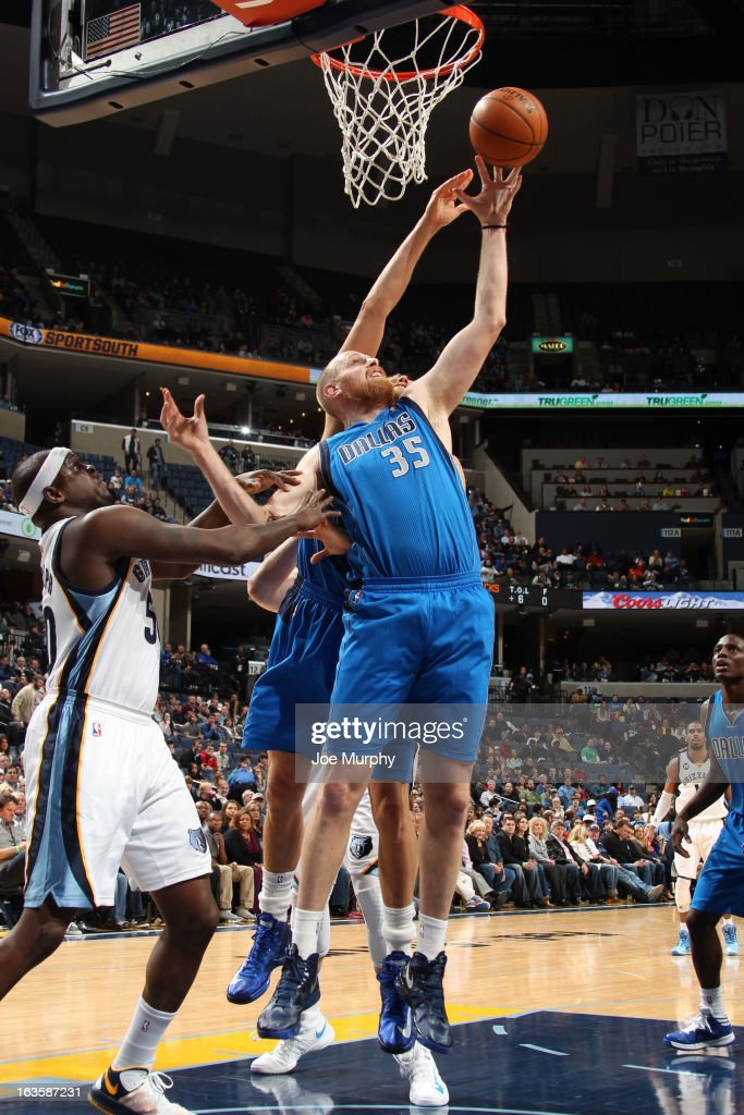 <a gi-track='captionPersonalityLinkClicked' href=/galleries/search?phrase=Chris+Kaman&family=editorial&specificpeople=201661 ng-click='$event.stopPropagation()'>Chris Kaman</a> #35 of the Dallas Mavericks rebounds against <a gi-track='captionPersonalityLinkClicked' href=/galleries/search?phrase=Zach+Randolph&family=editorial&specificpeople=201595 ng-click='$event.stopPropagation()'>Zach Randolph</a> #50 of the Memphis Grizzlies on February 27, 2013 at FedExForum in Memphis, Tennessee.