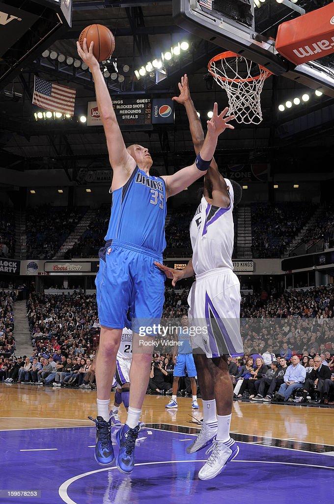 Chris Kaman #35 of the Dallas Mavericks shoot against John Salmons #5 of the Sacramento Kings on January 10, 2013 at Sleep Train Arena in Sacramento, California.