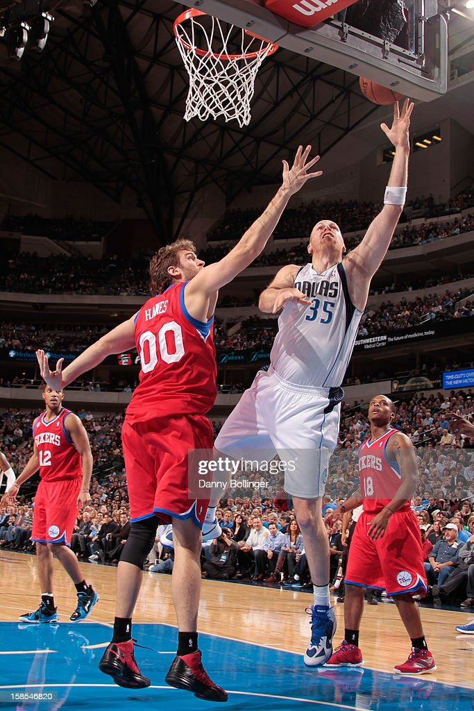 <a gi-track='captionPersonalityLinkClicked' href=/galleries/search?phrase=Chris+Kaman&family=editorial&specificpeople=201661 ng-click='$event.stopPropagation()'>Chris Kaman</a> #35 of the Dallas Mavericks shoots a layup against <a gi-track='captionPersonalityLinkClicked' href=/galleries/search?phrase=Spencer+Hawes&family=editorial&specificpeople=3848319 ng-click='$event.stopPropagation()'>Spencer Hawes</a> #00 of the Philadelphia 76ers on December 18, 2012 at the American Airlines Center in Dallas, Texas.