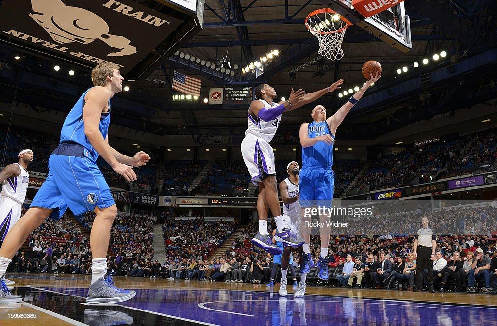Chris Kaman #35 of the Dallas Mavericks shoots against Jason Thompson #34 of the Sacramento Kings on January 10, 2013 at Sleep Train Arena in Sacramento, California.