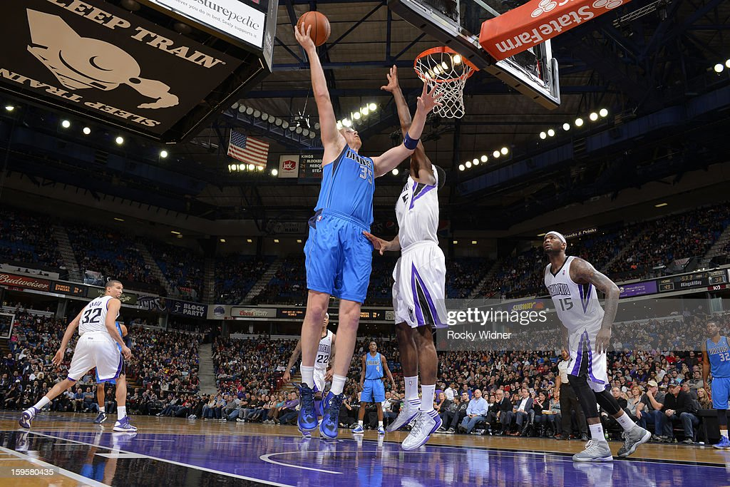 <a gi-track='captionPersonalityLinkClicked' href=/galleries/search?phrase=Chris+Kaman&family=editorial&specificpeople=201661 ng-click='$event.stopPropagation()'>Chris Kaman</a> #35 of the Dallas Mavericks shoots against <a gi-track='captionPersonalityLinkClicked' href=/galleries/search?phrase=John+Salmons&family=editorial&specificpeople=202524 ng-click='$event.stopPropagation()'>John Salmons</a> #5 of the Sacramento Kings on January 10, 2013 at Sleep Train Arena in Sacramento, California.