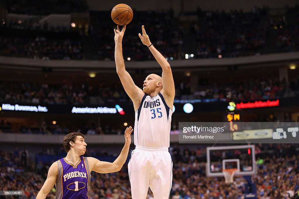 Chris Kaman #35 of the Dallas Mavericks takes a shot against Goran Dragic #1 of the Phoenix Suns at American Airlines Center on January 27, 2013 in Dallas, Texas.