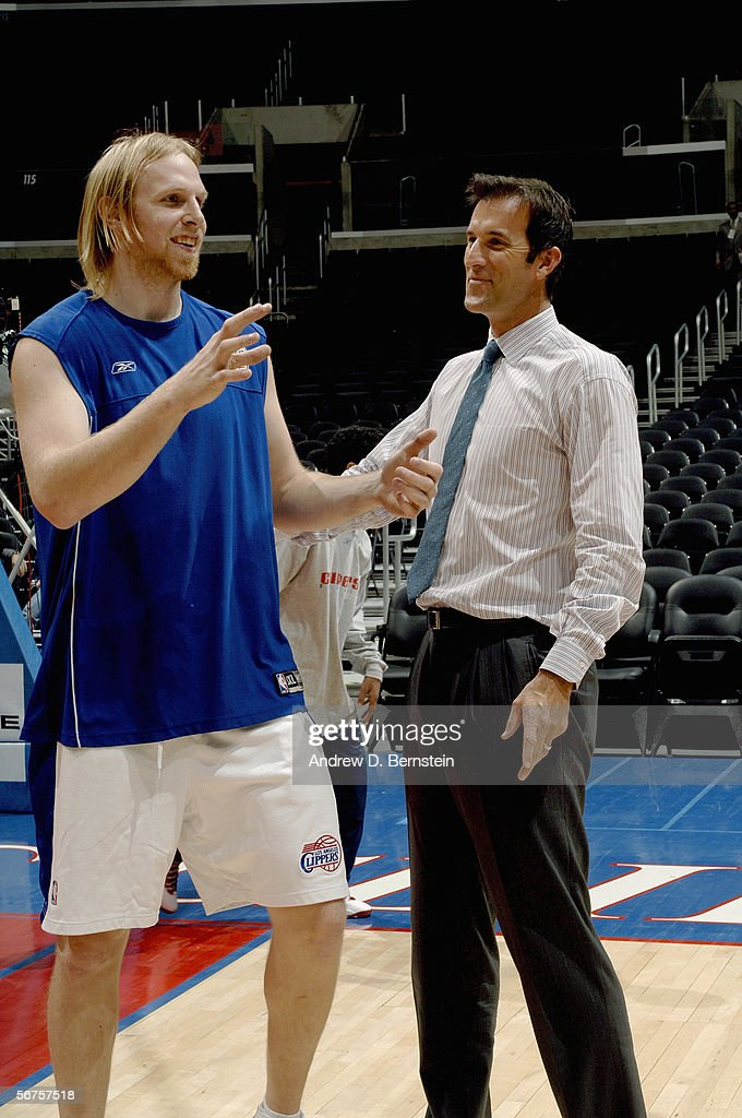 Chris Kaman of the Los Angeles Clippers and Clippers' TV broadcaster Michael Smith talk before the game with the Dallas Mavericks on January 20 2006...
