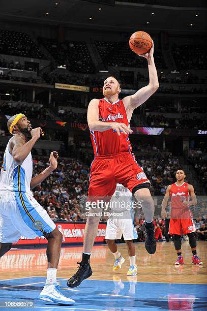 Chris Kaman of the Los Angeles Clippers shoots over Melvin Ely of the Denver Nuggets on November 5 2010 at the Pepsi Center in Denver Colorado NOTE...