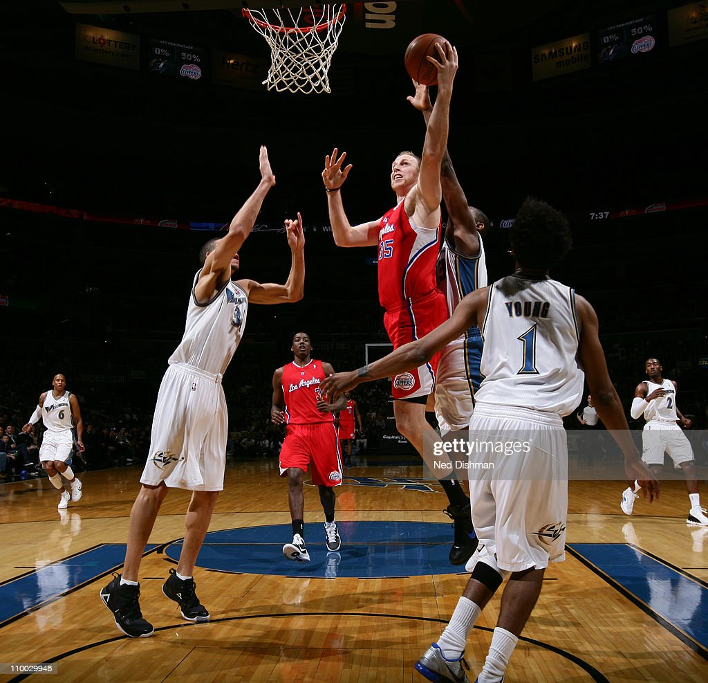 <a gi-track='captionPersonalityLinkClicked' href=/galleries/search?phrase=Chris+Kaman&family=editorial&specificpeople=201661 ng-click='$event.stopPropagation()'>Chris Kaman</a> #35 of the Los Angeles Clippers shoots over the Washington Wizards at the Verizon Center on March 12, 2011 in Washington, DC.