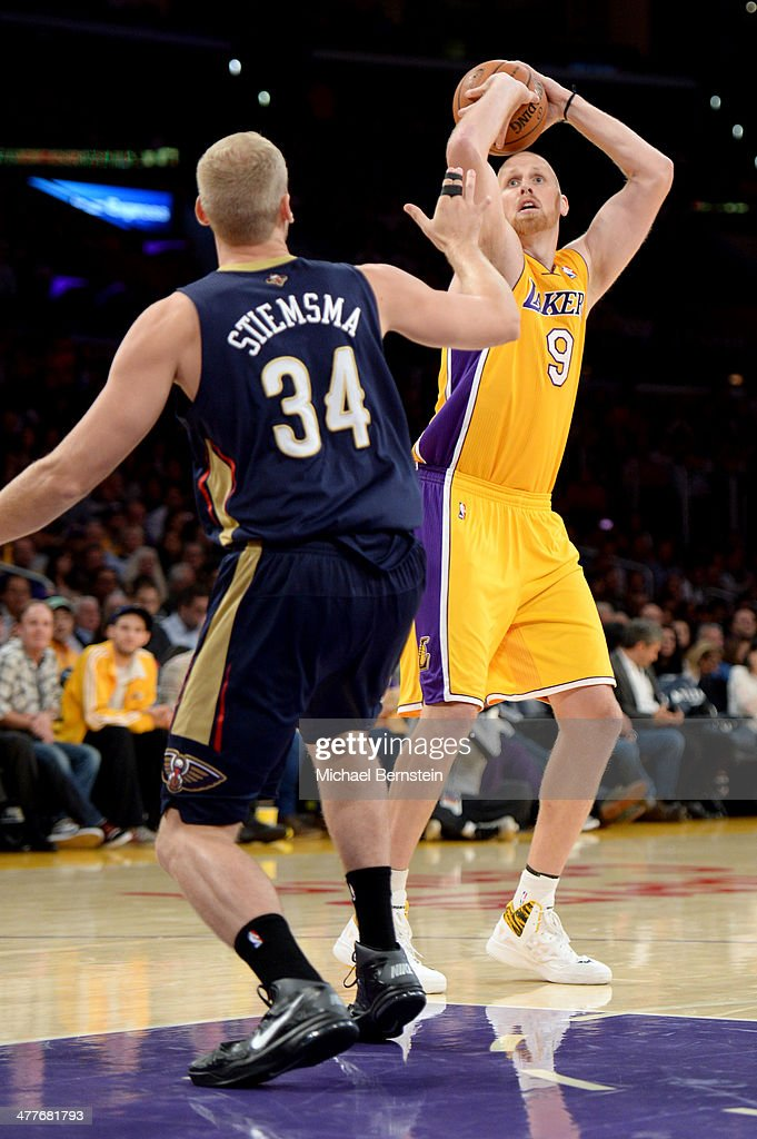 Chris Kaman #9 of the Los Angeles Lakers attempts a shot against the New Orleans Pelicans at Staples Center on November 12, 2013 in Los Angeles, California.