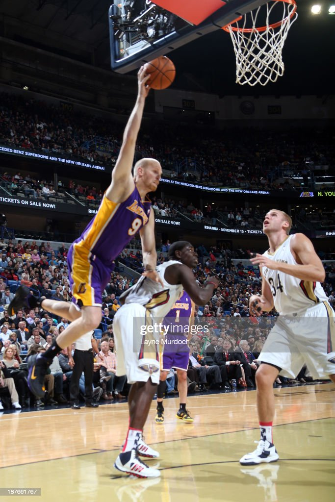 <a gi-track='captionPersonalityLinkClicked' href=/galleries/search?phrase=Chris+Kaman&family=editorial&specificpeople=201661 ng-click='$event.stopPropagation()'>Chris Kaman</a> #9 of the Los Angeles Lakers shoots the ball against the New Orleans Pelicans on November 8, 2013 at the New Orleans Arena in New Orleans, Louisiana.