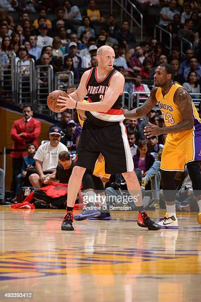 Chris Kaman of the Portland Trail Blazers defends the ball against the Los Angeles Lakers during the preseason game on October 19 2015 at STAPLES...