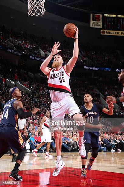 Chris Kaman of the Portland Trail Blazers goes for the layup against the New Orleans Pelicans during the game on April 4 2015 at Moda Center in...