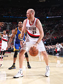 Chris Kaman of the Portland Trail Blazers handles the ball against the Golden State Warriors on November 2 2014 at the Moda Center Arena in Portland...