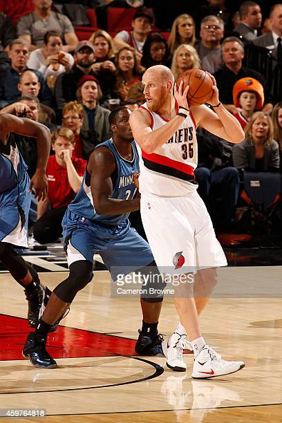 Chris Kaman of the Portland Trail Blazers handles the ball against the Minnesota Timberwolves on November 30 2014 at the Moda Center in Portland...