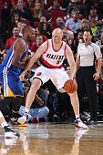 Chris Kaman of the Portland Trail Blazers handles the ball against the Golden State Warriors during a preseason game on October 8 2015 at the Moda...