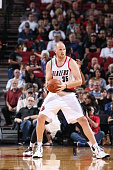 Chris Kaman of the Portland Trail Blazers handles the ball during the game against the Utah Jazz on October 9 2014 at the Moda Center Arena in...
