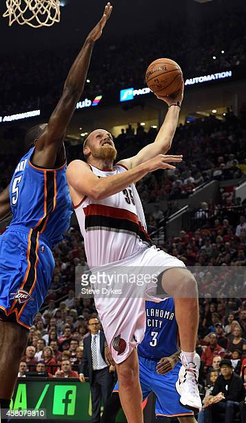 Chris Kaman of the Portland Trail Blazers has his shot blocked by Kendrick Perkins of the Oklahoma City Thunder during the fourth quarter of the game...