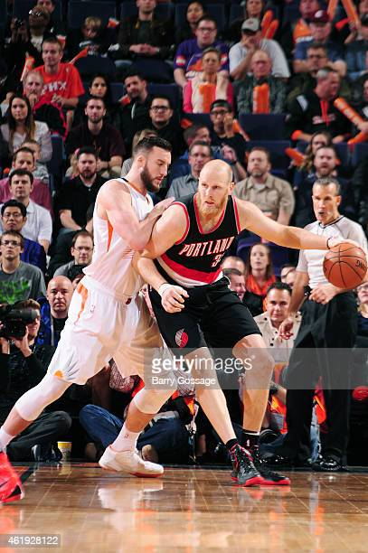 Chris Kaman of the Portland Trail Blazers is guarded by Miles Plumlee of the Phoenix Suns on January 21 2015 at US Airways Center in Phoenix Arizona...