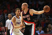 Chris Kaman of the Portland Trail Blazers keeps the ball away from Blake Griffin of the Los Angeles Clippers in the second half during the NBA game...