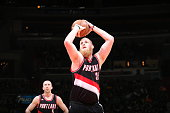 Chris Kaman of the Portland Trail Blazers prepares to shoot a free throw against the Washington Wizards on March 16 2015 at the Verizon Center in...