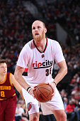 Chris Kaman of the Portland Trail Blazers shoots a free throw during the game against the Cleveland Cavaliers on November 4 2014 at the Moda Center...