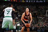 Chris Kaman of the Portland Trail Blazers shoots against Jared Sullinger of the Boston Celtics on November 23 2014 at TD Garden in Boston...