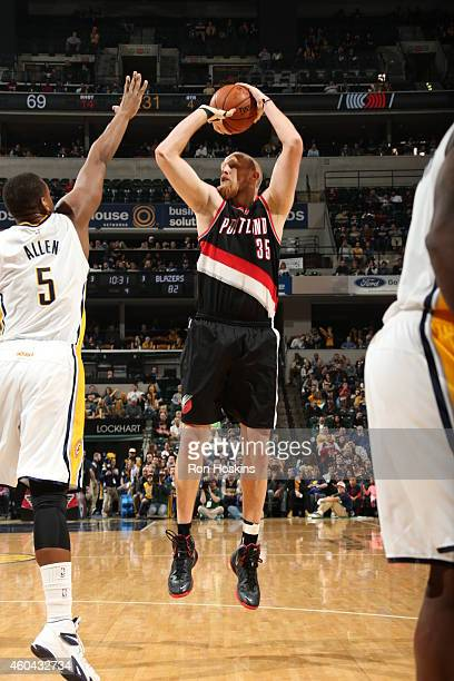 Chris Kaman of the Portland Trail Blazers shoots against Lavoy Allen of the Indiana Pacers on December 13 2014 at Bankers Life Fieldhouse in...