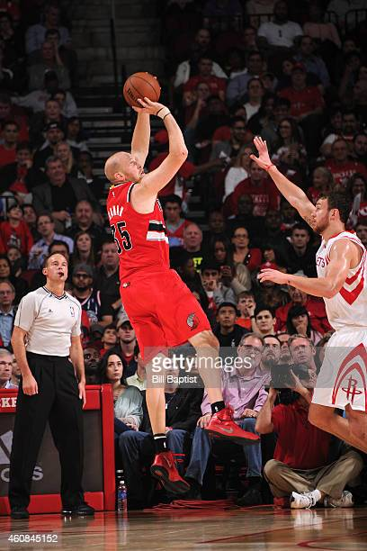 Chris Kaman of the Portland Trail Blazers shoots against the Houston Rockets on December 19 2014 at Wells Fargo Center in Philadelphia PA NOTE TO...