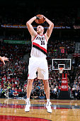 Chris Kaman of the Portland Trail Blazers shoots against the Los Angeles Clippers on October 12 2014 at the Moda Center Arena in Portland Oregon NOTE...