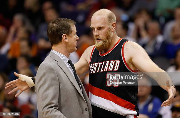 Chris Kaman of the Portland Trail Blazers talks with head coach Terry Stotts during a break from the first half of the NBA game against the Phoenix...