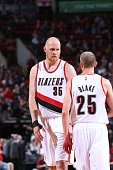 Chris Kaman of the Portland Trail Blazers talks with teammate Steve Blake of the Portland Trail Blazers on October 12 2014 at the Moda Center Arena...