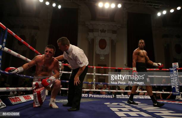 Chris Keane stops Shane McPhilbin during the Vacant Midlands Area Cruiserweight Championship at the Walsall Town Hall Walsall