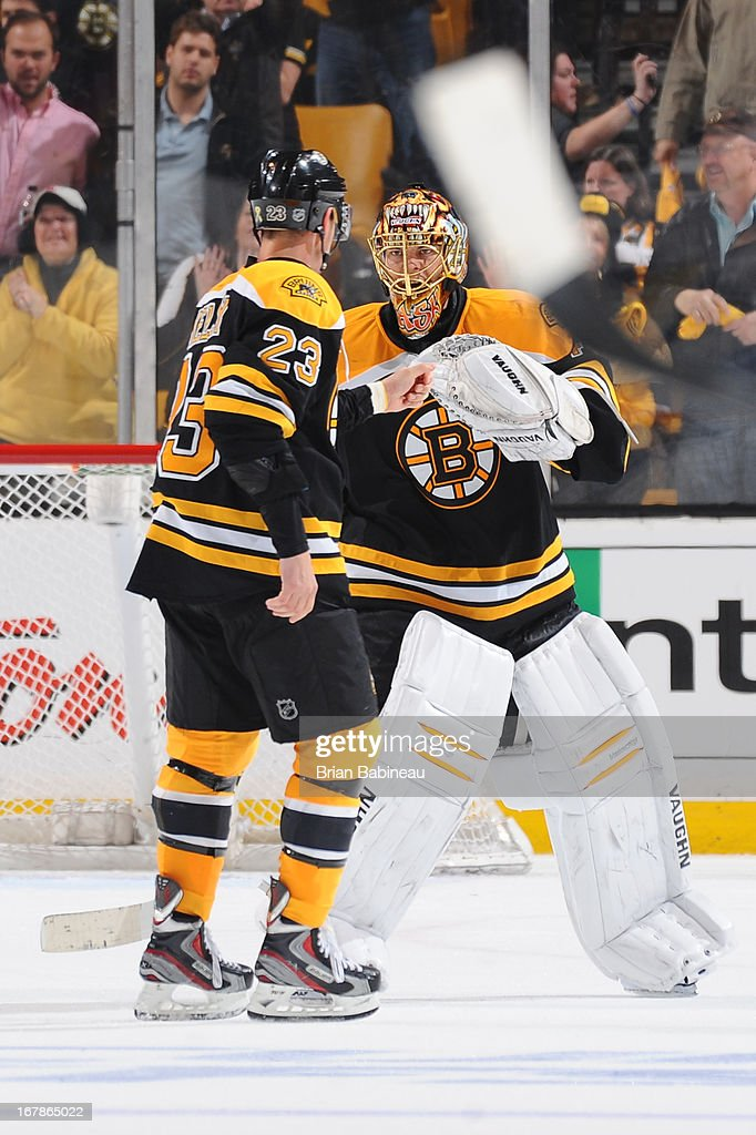 Chris Kelly #23 and <a gi-track='captionPersonalityLinkClicked' href=/galleries/search?phrase=Tuukka+Rask&family=editorial&specificpeople=716723 ng-click='$event.stopPropagation()'>Tuukka Rask</a> #40 of the Boston Bruins fist bump against the Toronto Maple Leafs in Game One of the Eastern Conference Quarterfinals during the 2013 NHL Stanley Cup Playoffs at TD Garden on May 1, 2013 in Boston, Massachusetts.