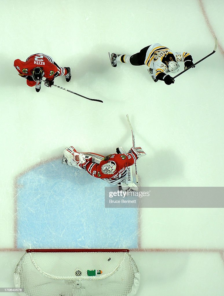 Chris Kelly #23 of the Boston Bruins celebrates after Daniel Paille #20 scored the game-winning goal in overtime to win 2-1 against <a gi-track='captionPersonalityLinkClicked' href=/galleries/search?phrase=Duncan+Keith&family=editorial&specificpeople=4194433 ng-click='$event.stopPropagation()'>Duncan Keith</a> #2 and goalie <a gi-track='captionPersonalityLinkClicked' href=/galleries/search?phrase=Corey+Crawford&family=editorial&specificpeople=818935 ng-click='$event.stopPropagation()'>Corey Crawford</a> #50 of the Chicago Blackhawks Game Two of the NHL 2013 Stanley Cup Final at United Center on June 15, 2013 in Chicago, Illinois.