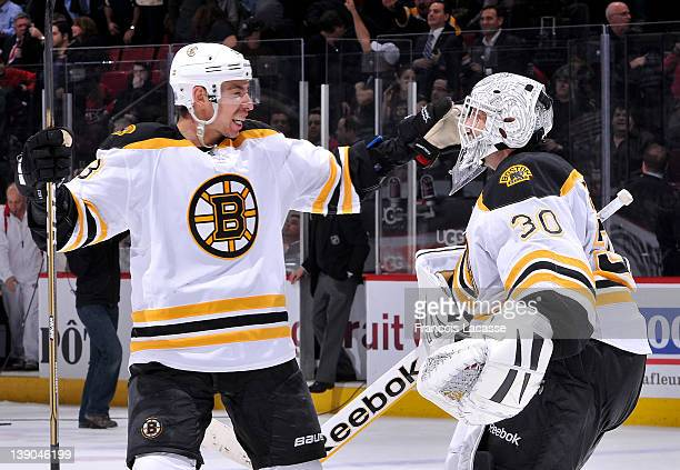 Chris Kelly of the Boston Bruins celebrates shootout victory with goaltender Tim Thomas after the NHL game against the Montreal Canadiens on February...