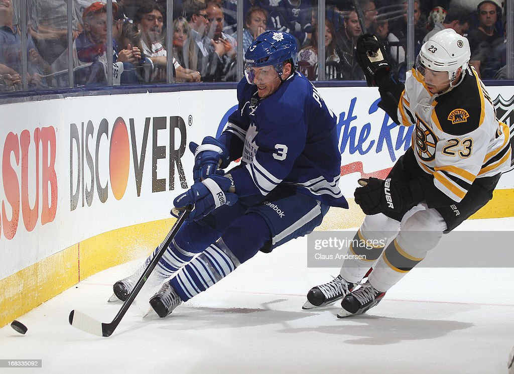 Chris Kelly #23 of the Boston Bruins chases after <a gi-track='captionPersonalityLinkClicked' href=/galleries/search?phrase=Dion+Phaneuf&family=editorial&specificpeople=545455 ng-click='$event.stopPropagation()'>Dion Phaneuf</a> #3 of the Toronto Maple Leafs in Game Four of the Eastern Conference Quarterfinals during the 2013 NHL Stanley Cup Playoffs on May 8, 2013 at the Air Canada Centre in Toronto, Ontario, Canada.