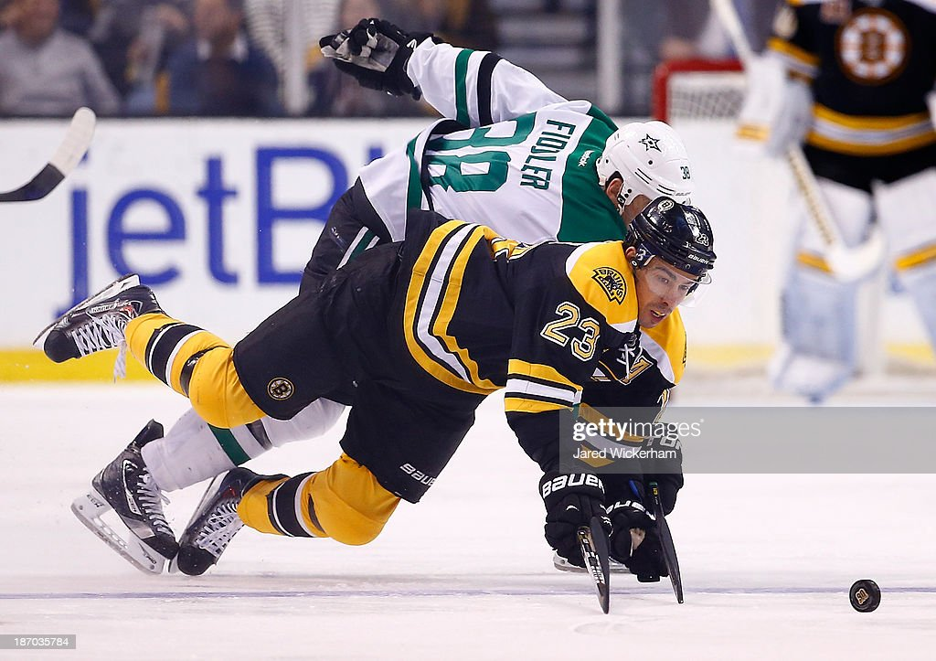 Chris Kelly #23 of the Boston Bruins dives for a puck in front of <a gi-track='captionPersonalityLinkClicked' href=/galleries/search?phrase=Vernon+Fiddler&family=editorial&specificpeople=208086 ng-click='$event.stopPropagation()'>Vernon Fiddler</a> #38 of the Dallas Stars in the first period at TD Garden on November 5, 2013 in Boston, Massachusetts.